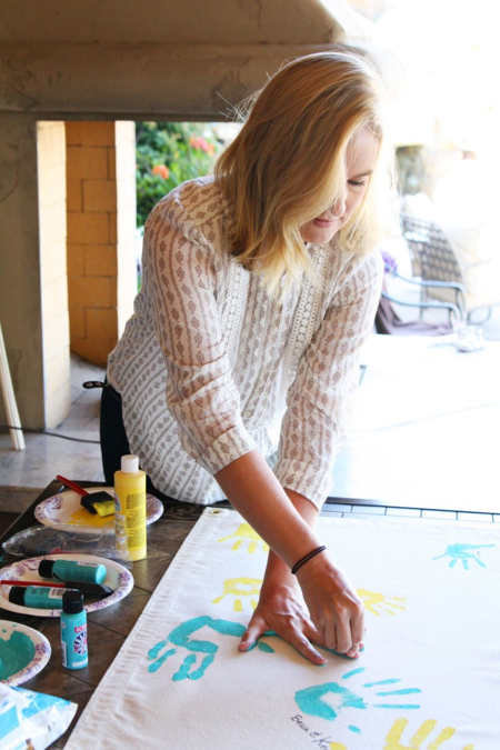 Making a family flag with handprints at the family reunion     Find Joy in the Journey