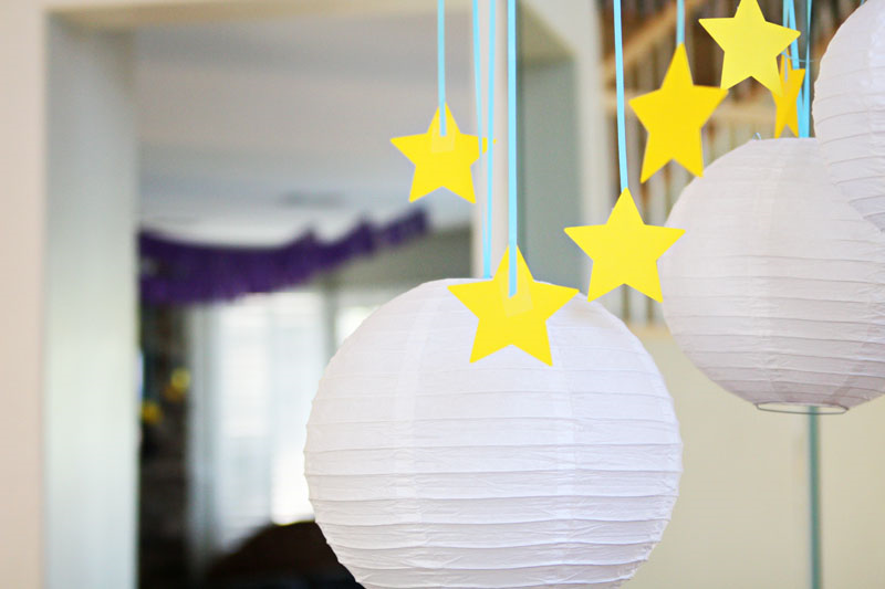 Night Owl Party decorations - paper lanterns and hanging stars add to the night time theme | Find Joy in the Journey