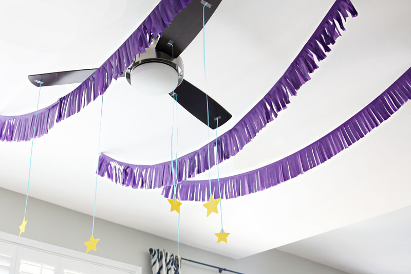 Night Owl Party Decorations - Use plastic tablecloths to create easy and cheap party garlands!  | Find Joy in the Journey